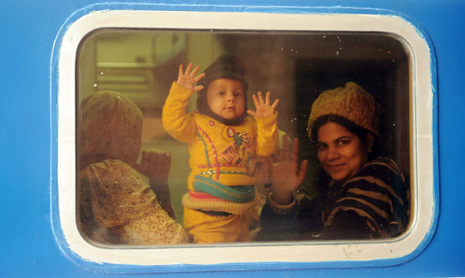 Passengers wave as they sit in a newly launched Pak Business Express train prior to departure in Lahore on February 3, 2012. ? AFP Photo