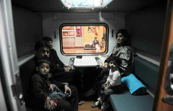 Passengers sit in a newly launched Pak Business Express train prior to departure in Lahore on February 3, 2012. ? AFP Photo