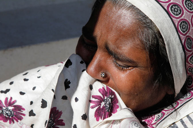 A Pakistani woman cries at the site of a building which collapsed in Lahore, Pakistan, Monday, Feb. 6, 2012. ? AP Photo