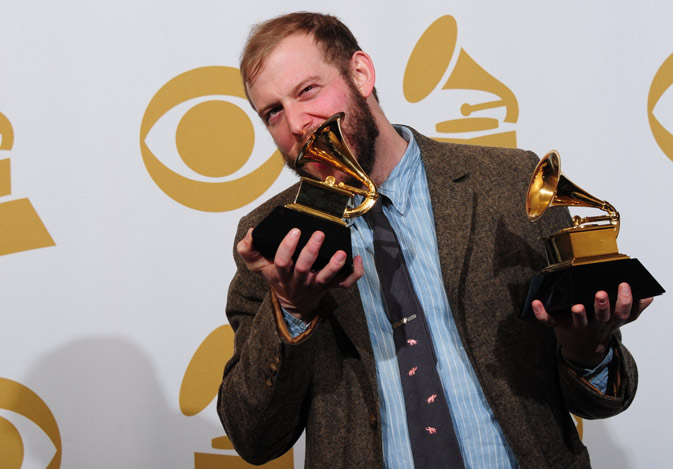 "Justin Vernon of Bon Iver poses with the Best Alternative Music Album ""Bon Iver"" award and the Best New Artist award. ? AFP Photo"