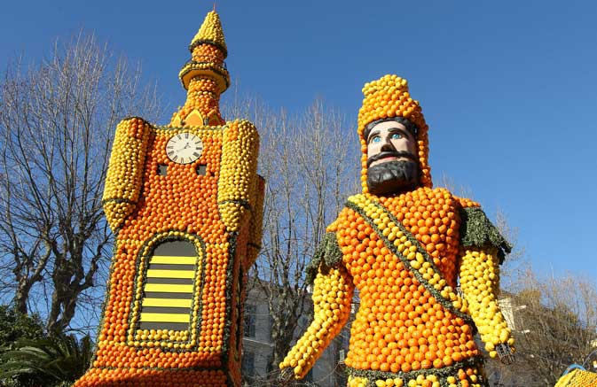 "A picture shows sculptures made with oranges and lemons representing a ""beffroi"" (Belfry) and a ""giant"" symbolising the Northern region of France on February 16, 2012 in Menton on the French Riviera, ahead of the start of the ""Fete du Citron"" .? AFP Photo"