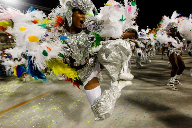 Performers from the Mocidade Independente de Padre Miguel samba school parade during carnival celebrations at the Sambadrome in Rio de Janeiro, Brazil, Monday, Feb.20, 2012. ?AP Photo