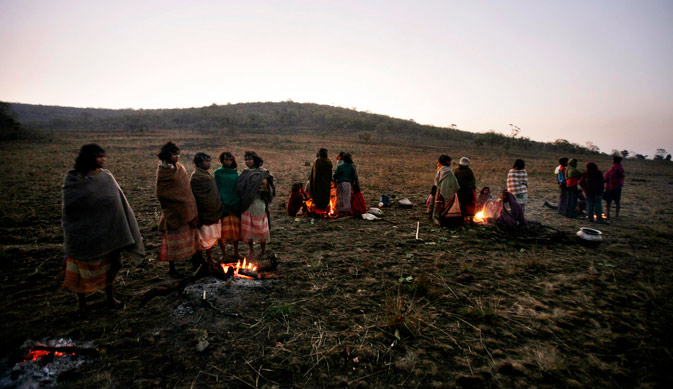 In this photo taken Sunday, Feb. 26, 2012, Indian Dongaria Kondh tribals warm themselves over fires during the annual festival of Niyam Raja in Lanjigarh at the sacred Niyamgiri Hill, about 400 kilometers (249 miles) from the eastern Indian city of Bhubaneswar, Orissa, India. ?AP Photo