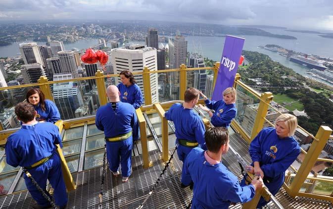 Newly introduced couples are given five minutes to talk to each potential partner at the summit of the Sydney Tower.  Standing at 260 metres above street level, Sydney's highest viewing platform, a total of 14 singles search for a love match by speed dating on Valentine's Day while enjoying breathtaking views. – AFP Photo.