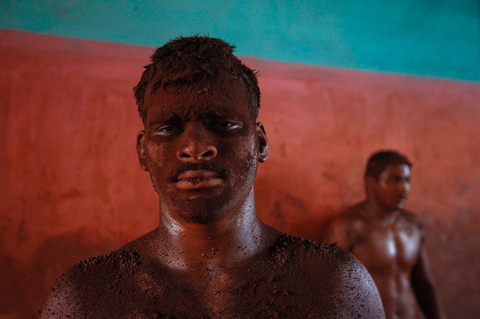 A mud-covered wrestler trains at a traditional Indian mud wrestling (Kushti) centre called Akhaara in Kolhapur, about 400 kms (250 miles) south of Mumbai.? Reuters Photo