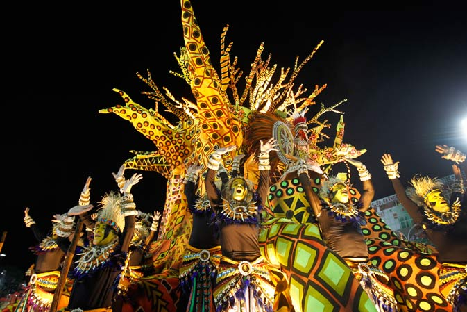 Performers from the Unidos da Vila Isabel samba school parade during carnival celebrations at the Sambadrome in Rio de Janeiro, Brazil, Monday, Feb.20, 2012.   Millions watched the sequin-clad samba dancers at Rio de Janeiro's iconic Carnival parade.   ?AP Photo