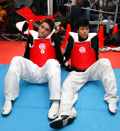 Wearing red chest and back guards made from the material used in bullet-proof vests, the pair, who both recently qualified for the Games in Bangkok, make high-pitched screeches as they take aim, typical of the sport.