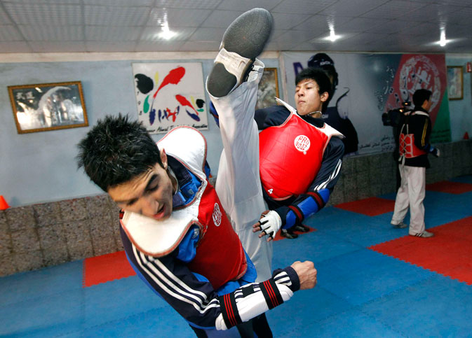 On the other side of Kabul from Ghazi stadium, in an equally barren practice space, 24-year-old Nikpai and fellow taekwondo Olympic contender Nesar Ahmad Bahawi kick and punch in preparation for competition at London's ExCel centre in August.