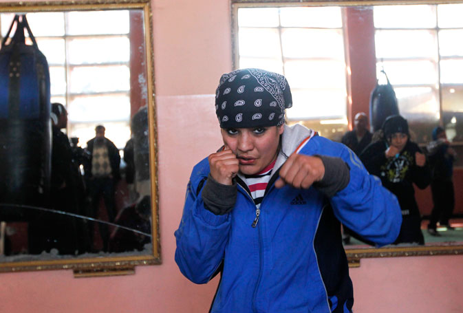 Coach Mohammad Saber Sharifi, a former professional boxer and advocate of Afghan women's rights, especially through sport, said Rahimi had been granted a wild card to compete at the Olympics, meaning she can sidestep further qualifying rounds.  She will soon leave Kabul's rutted and snowbound streets for London to train for the Olympics, where women's boxing is debuting as a sport, he said.