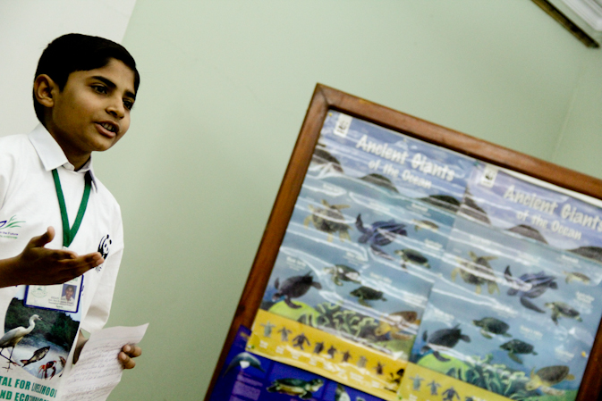 A Student giving a speech on mangroves.