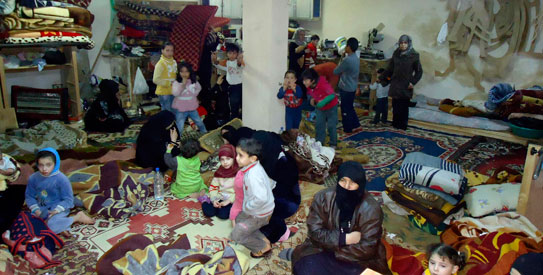 Residents take shelter in Baba Amro, an opposition stronghold in the central city of Homs February 15, 2012. — Photo by Reuters
