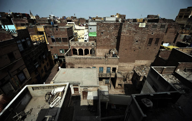 Dilapidated buildings and residences are pictured in the old town section of Multan on March 17, 2012. ?AFP Photo