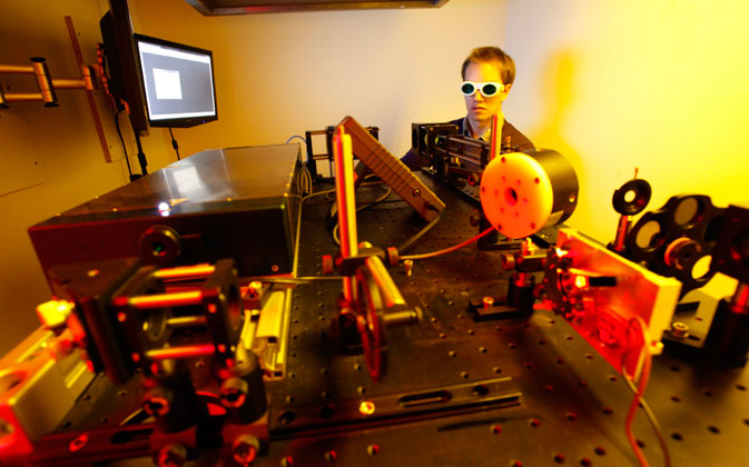 Dissertation student Jan Torgersen of Vienna University of Technology operates a newly developed 3D laser printer, in Vienna March 29, 2012. ? Reuters Photo
