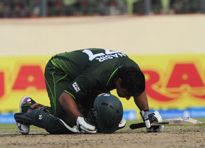 Pakistan's Nasir Jamshed bows towards Mecca after scoring a century (100 runs) during the one day international (ODI) Asia Cup cricket match between India and Pakistan at The Sher-e-Bangla National Cricket Stadium in Dhaka. ? AFP Photo.