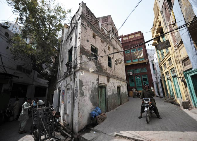 Local residents are seen in narrow alleys in the old town section of Multan.  ?AFP Photo