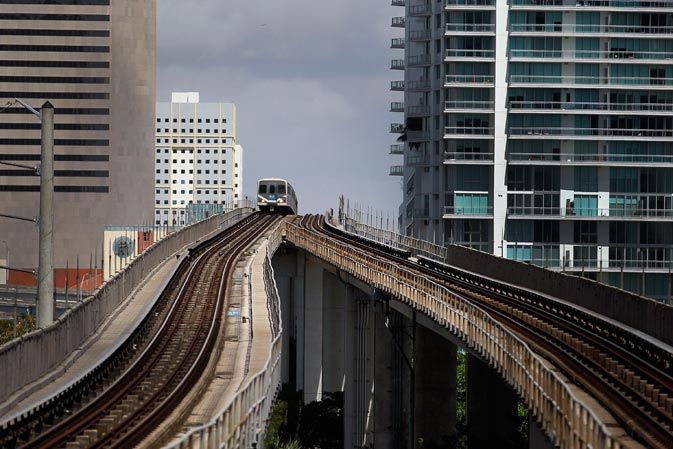 A Miami-Dade county Metrorail train arrives at a station in Miami, Florida. With gas prices on the rise, mass transit systems around the country have seen a 2.31 percent rise in ridership during 2011 over the previous year according to the American Public Transportation Association. ? AFP Photo