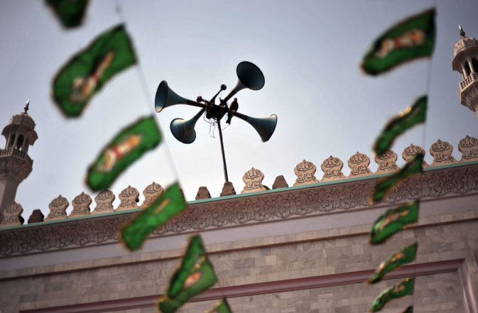 A pigeon rests on loudspeakers at a mosque in the old town section of Multan on March 17, 2012. ?AFP Photo