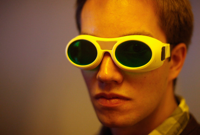 Dissertation student Jan Torgersen of Vienna University of Technology wears safety goggles in front of a newly developed 3D laser printer, in Vienna. ? Reuters Photo
