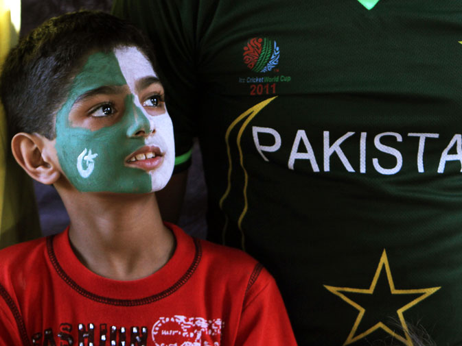 A Pakistani supporter reacts while watching the match. -AFP Photo