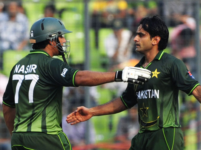 Pakistan's Nasir Jamshed (L) congratulates his teammate Mohammad Hafeez (R) on scoring a century. -AFP Photo