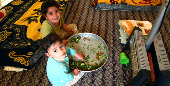 Syrian refugee children eat in a tent at the Red Crescent camp in Boynuyogun village, Hatay region . – AFP photo