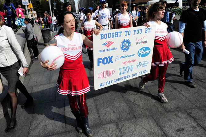 """Members of Occupy Wall Street dressed as a baseball team named """"The Tax Dodgers"""" (rear) participate in a rally near Central Park in New York April 14, 2012. – Reuters Photo."""