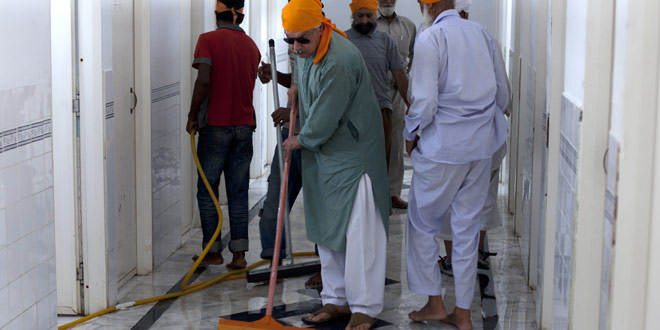 Muhammed Khurshid Khan has traveled to Sikh shrines in Pakistan and India, volunteering to polish shoes, clean bathrooms, cook meals and do other chores. – Photo by AP