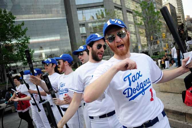 """Members of the Occupy Wall Street dressed as a baseball team named """"The Tax Dodgers"""" participate in a rally near Central Park in New York April 14, 2012. – Reuters Photo."""