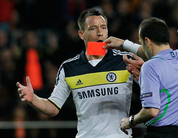 Chelsea's John Terry, left, gets a red card from the referee during a Champions League second leg semifinal soccer match against Barcelona at Camp Nou stadium, in Barcelona, Spain, Tuesday, April 24, 2012. Chelsea drew 2-2 with Barcelona to win the match 3-2 on aggregate. ? Photo by AP