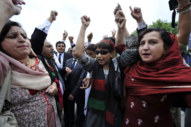 Supporters of Pakistan's Prime Minister Yousuf Raza Gilani shout slogans against the contempt of court verdict outside the Supreme Court building in Islamabad on April 26, 2012.  – Photo by AFP