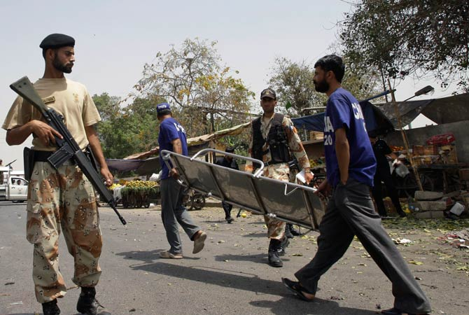 Pakistani security officials secure the area of a suicide attack in Karachi, Pakistan on Thursday, April 5, 2012. ?Photo by AP
