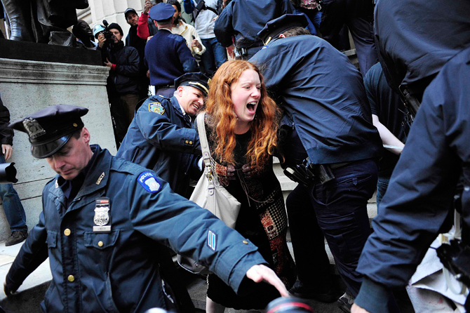 A woman participating in an Occupy Wall Street protest rally is arrested on the steps of Federal Hall on Wall Street across from the New York Stock Exchange in New York April 13, 2012. – Reuters Photo.