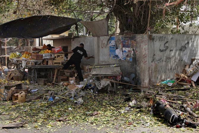 A Pakistani police officer searches the area after a suicide attack on Thursday, April 5, 2012. ?Photo by AP