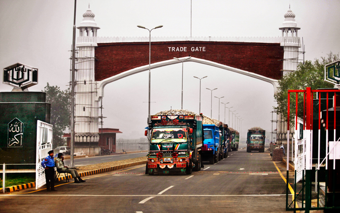 Pakistani trucks loaded with gypsum wait for signal from Indian customs before crossing into India at the recently inaugurated Integrated Check Post, a customs depot, at Attari near Amritsar, India. – AP Photo.