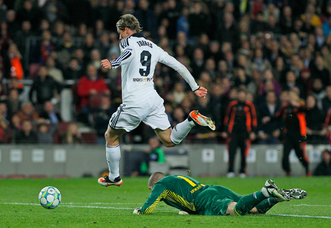 Chelsea's Fernando Torres from Spain, left, scores his goal during a Champions League second leg semifinal soccer match against Barcelona at Camp Nou stadium, in Barcelona, Spain, Tuesday, April 24, 2012. ? Photo by AP