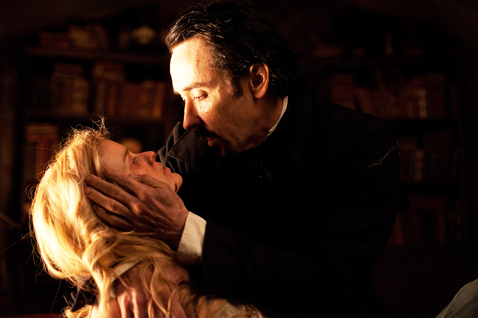 "John Cusack portrays Edgar Allan Poe, right, and Alice Eve portrays Emily Hamilton in a scene from the gothic thriller ""The Raven?. ? Photo by AP."