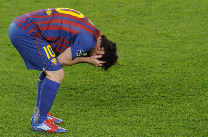 Barcelona's Argentinian forward Lionel Messi holds his head in his hands after losing to Chelsea after the UEFA Champions League second leg semi-final football match Barcelona against Chelsea at the Cam Nou stadium in Barcelona on April 24, 2012. ? Photo by AFP