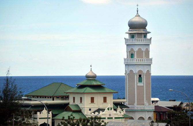 This picture taken in Banda Aceh on April 12 shows the Baiturrahim mosque that survived the 2004 Asian tsunami, located in the west coast of Sumatera in Banda Aceh. ? Photo by AFP
