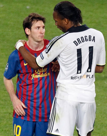 Chelsea's Didier Drogba (R) comforts Barcelona's Lionel Messi at the end of their Champions League semi-final second leg soccer match at Camp Nou stadium in Barcelona, April 24, 2012. ? Photo by Reuters