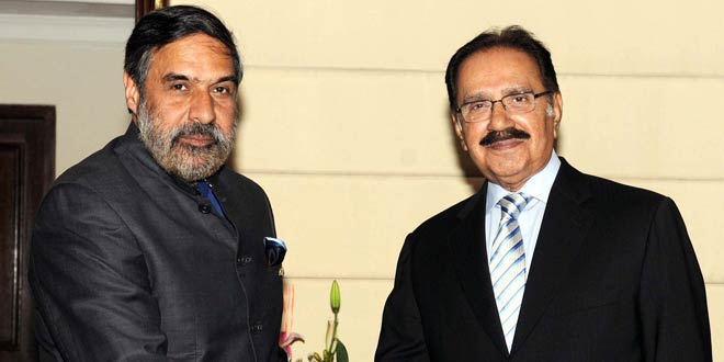 Pakistan Commerce Minister, Makhdoom Amin Fahim shakes hand with his Indian counterpart, Anand Sharma at the start of bilateral talks in New Delhi on Friday, April 13, 2012