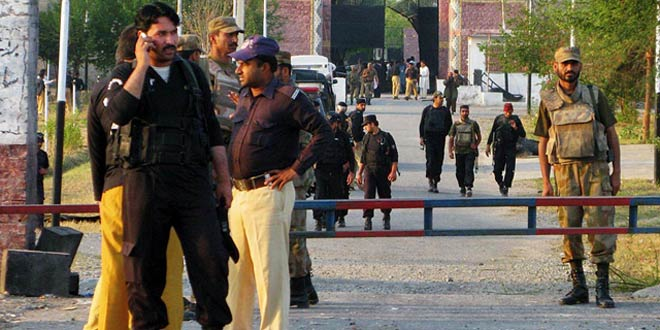 Police personnel standing inside the gate of Bannu Central Jail which is attacked by assailants on 15 April, 2012 Sunday. – Online Photo
