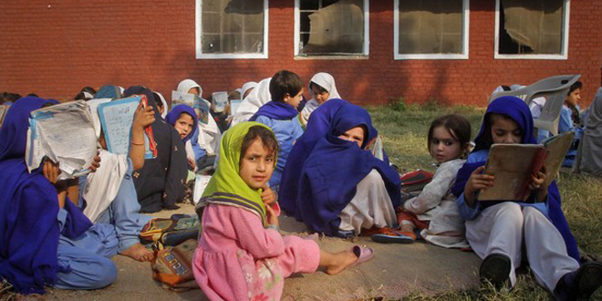 girls-attending-lesson-outside-a-school-in-Khyber-Pakhtunkhwa
