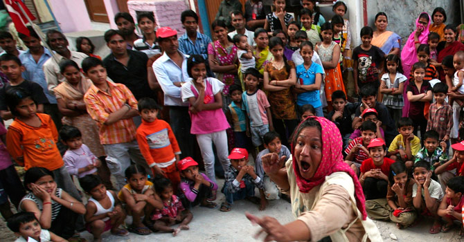 Moloyashree Hashmi from the Indian amateur theatre group Jana Natya Manch, or Janam, takes part in a street play about voting in a neighbourhood in west New Delhi.