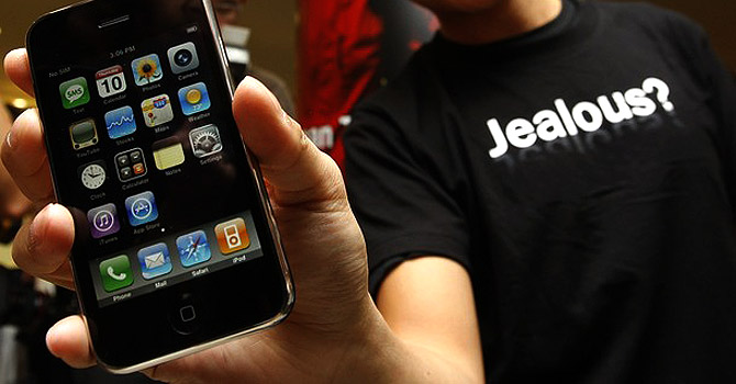 An Apple Iphone is displayed by a user. The PTA has delayed its auction for 3G licences in Pakistan.