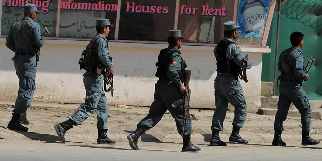 Afghan policemen arrive at the scene of attacks in Kabul on April 15, 2012.