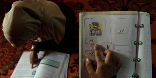 Kashmiri-students-read-inside-their-home