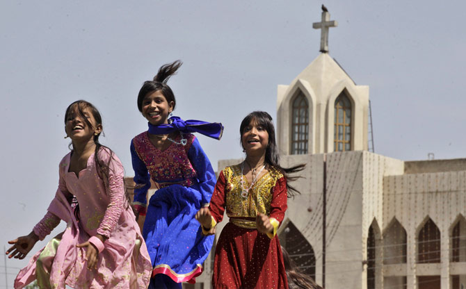 Pakistani Christian girls jump on a trampoline while celebrating Easter outside St. John's Church in Peshawar, Pakistan, Sunday, April 8, 2012. ? AP Photo