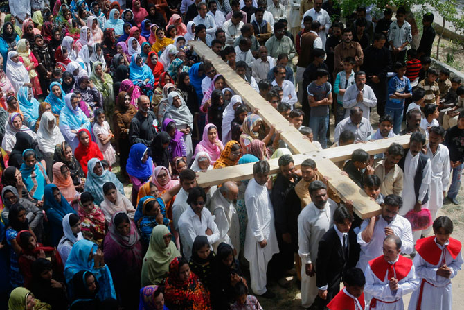 Pakistani Christians carry a cross through the streets of Quetta while observing Good Friday April 6, 2012. ? Reuters Photo