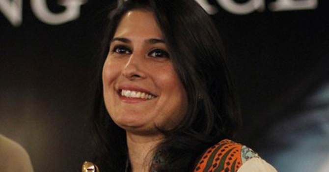 Sharmeen Obaid Chinoy, a Pakistani filmmaker holds her Oscar award trophy as she posses for media after a news conference in Karachi on March 10, 2012.