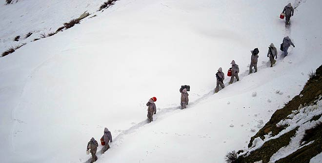 An avalanche buried at least 100 Pakistani soldiers near the Siachen glacier on the border with India.—AP Photo